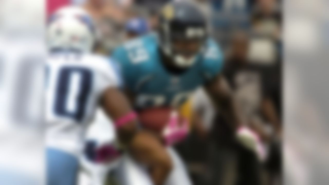 Jacksonville Jaguars tightend Marcedes Lewis looks for running room after making a catch against the Tennessee Titans during an NFL football game, Sunday, Oct. 4, 2009 in Jacksonville, Fla. (AP Photo/Stephen Morton)