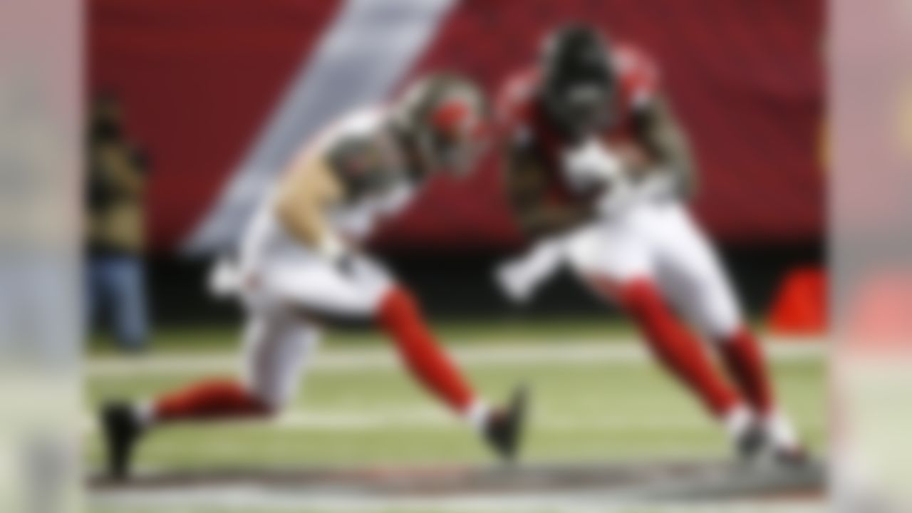 Atlanta Falcons wide receiver Julio Jones (11) runs as Tampa Bay Buccaneers strong safety Chris Conte (23) defends during the first of an NFL football game, Sunday, Nov. 1, 2015, in Atlanta. (AP Photo/John Bazemore)