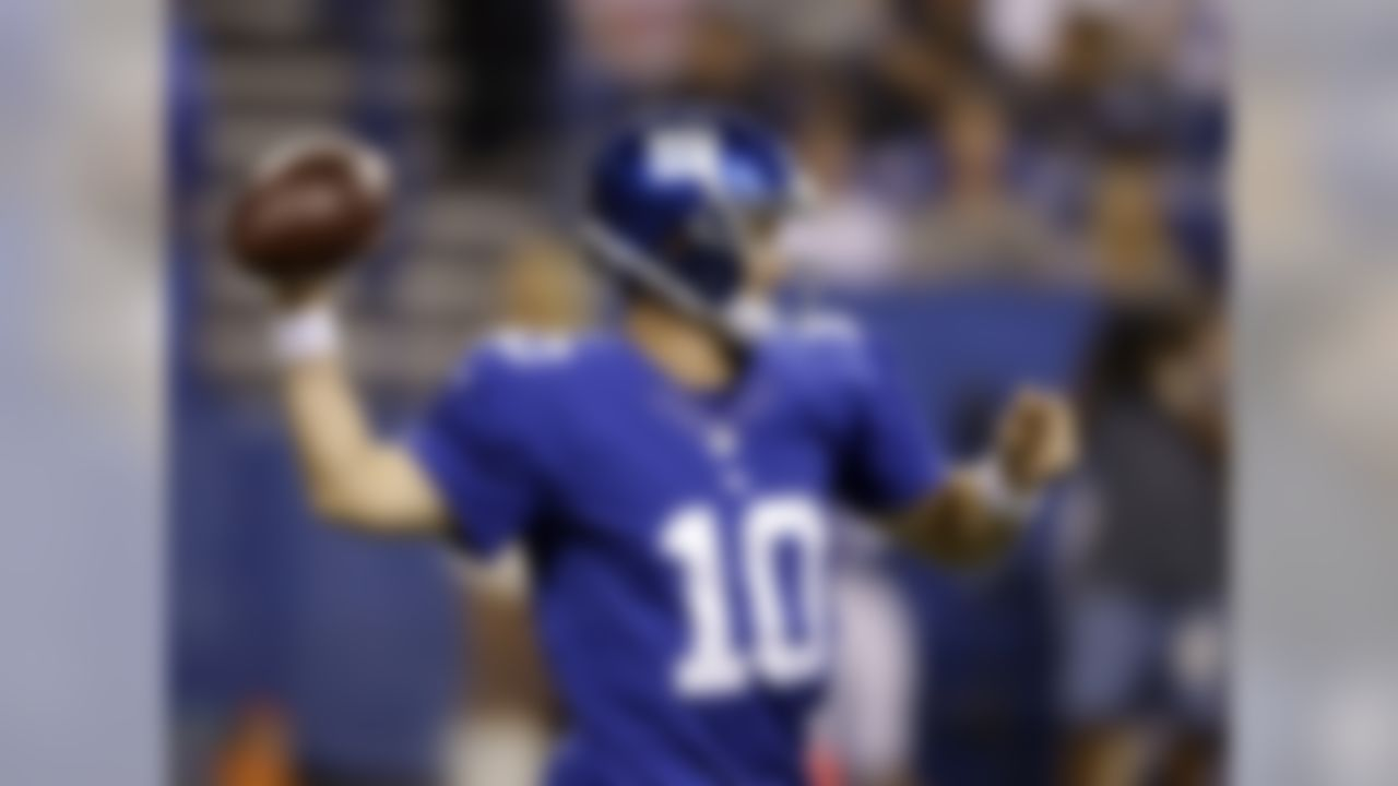 New York Giants quarterback Eli Manning throws during the first half of an NFL preseason football game against the Indianapolis Colts on Saturday, Aug. 16, 2014, in Indianapolis. (AP Photo/Darron Cummings)