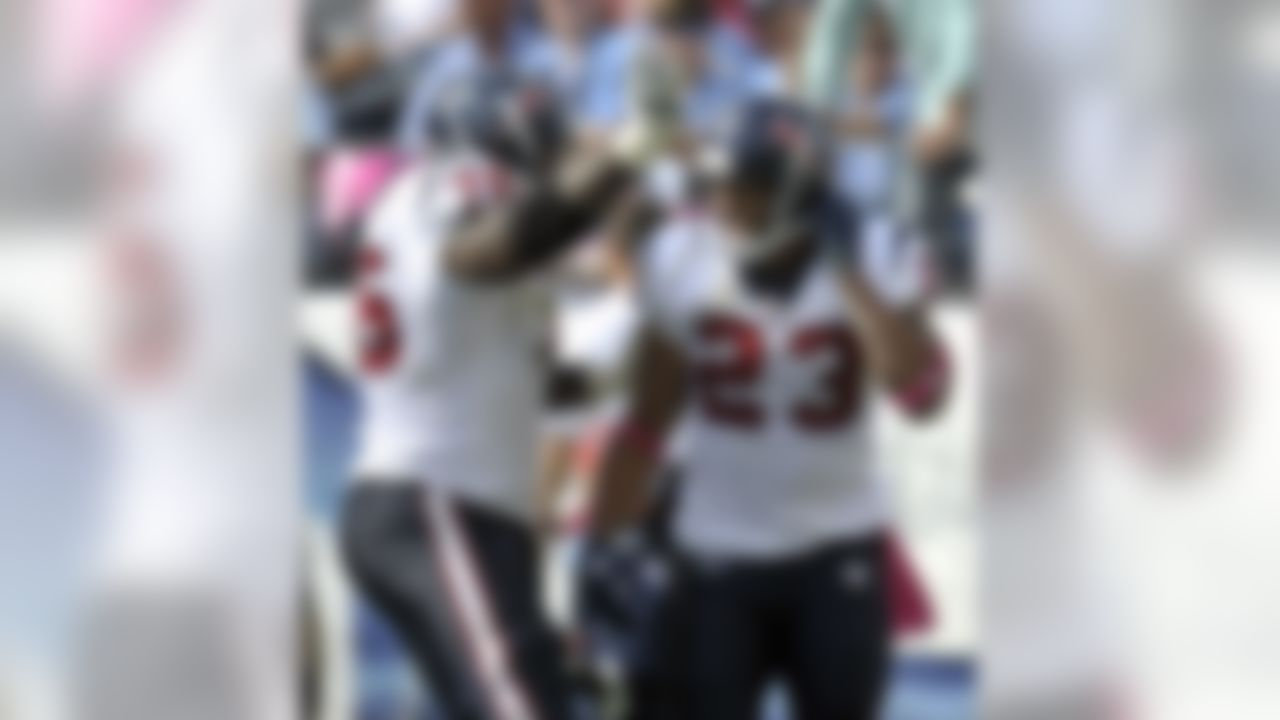 Houston Texans running back Arian Foster (23) celebrates with Duane Brown (76) after Foster scored a touchdown against the Tennessee Titans on a 1-yard run in the third quarter of an NFL football game Sunday, Oct. 23, 2011, in Nashville, Tenn. (AP Photo/Joe Howell)