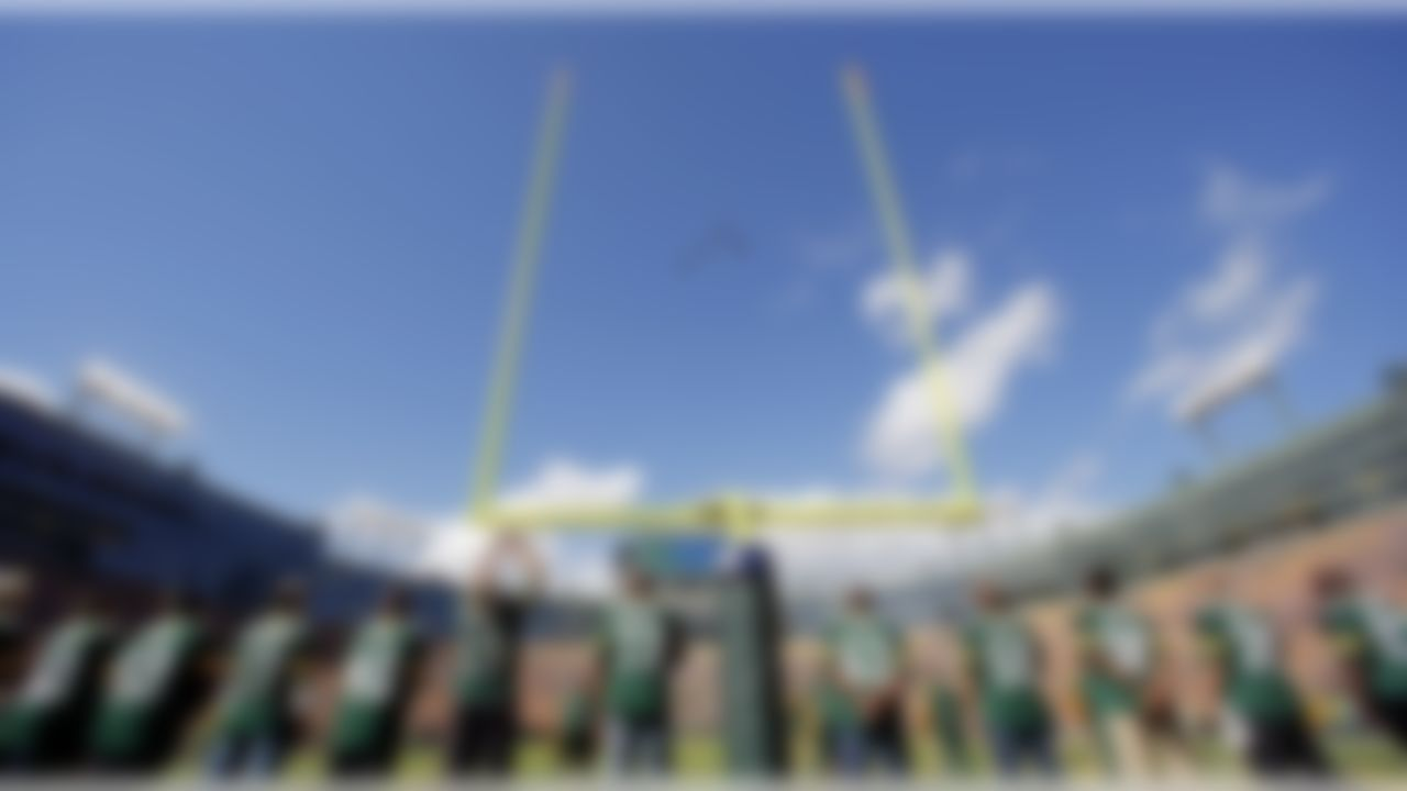Planes fly over Lambeau Field after the national anthem before an NFL football game between the Green Bay Packers and the San Francisco 49ers Sunday, Sept. 9, 2012, in Green Bay, Wis. (AP Photo/Jeffrey Phelps)