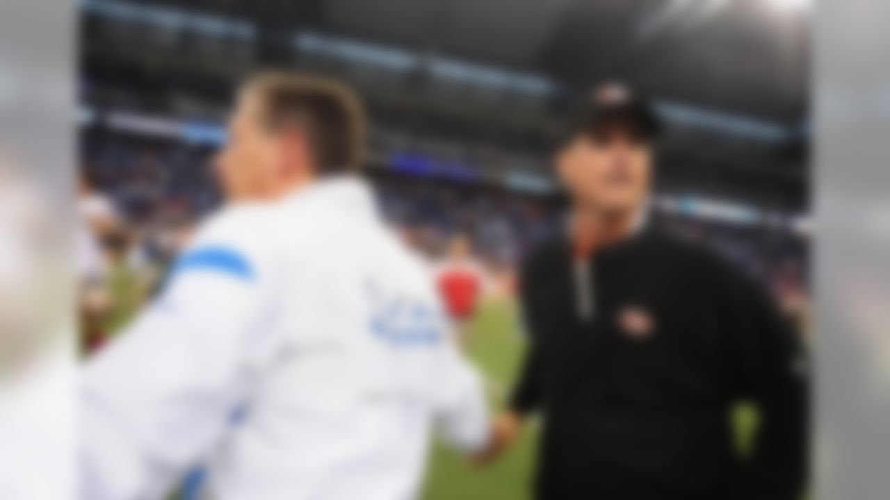 Oct 16, 2011; Detroit, OH, USA; Detroit Lions head coach Jim Schwartz (left) shakes hands with San Francisco 49ers head coach Jim Harbaugh at the end of the game at Ford Field. San Francisco 49ers defatted Detroit Lions 25-19. Mandatory Credit: Andrew Weber- US PRESSWIRE