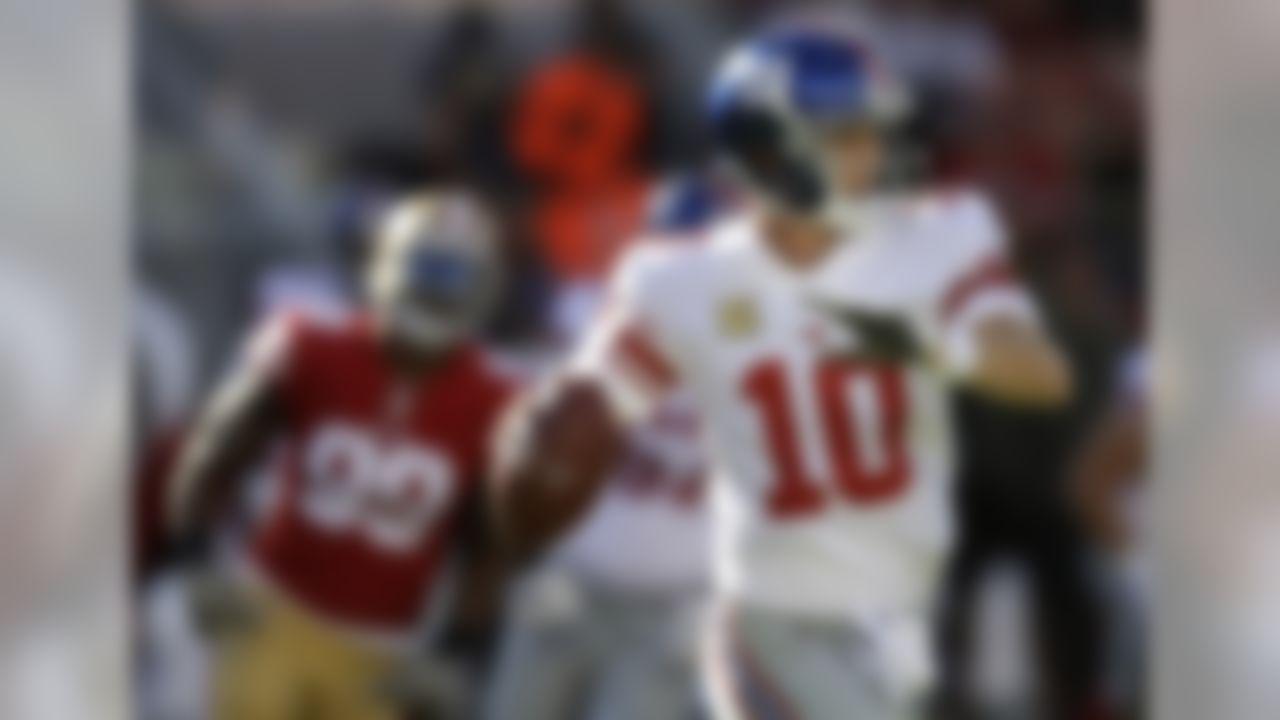 New York Giants quarterback Eli Manning (10) passes against the San Francisco 49ers during the first half of an NFL football game in Santa Clara, Calif., Sunday, Nov. 12, 2017. (AP Photo/Ben Margot)