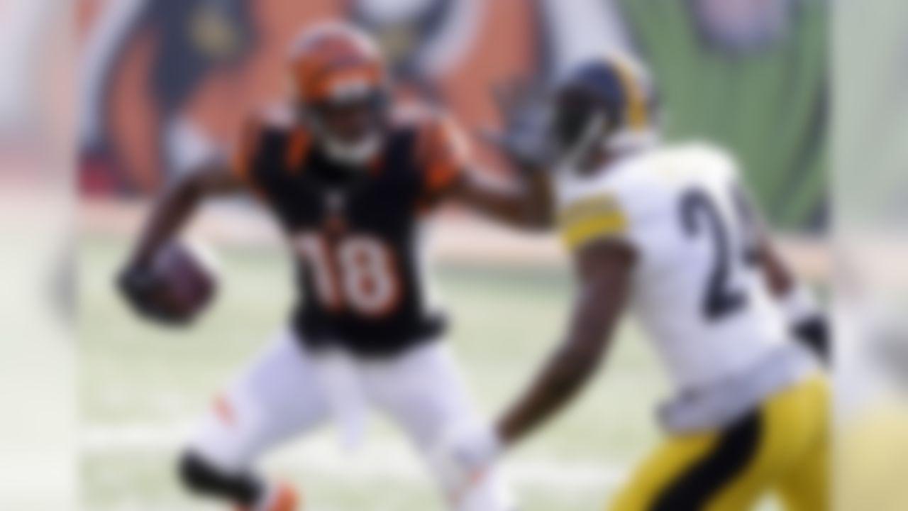 Cincinnati Bengals wide receiver A.J. Green (18) runs against Pittsburgh Steelers cornerback Ike Taylor (24) during the first half of an NFL football game Sunday, Dec. 7, 2014 in Cincinnati. (AP Photo/Michael Conroy)
