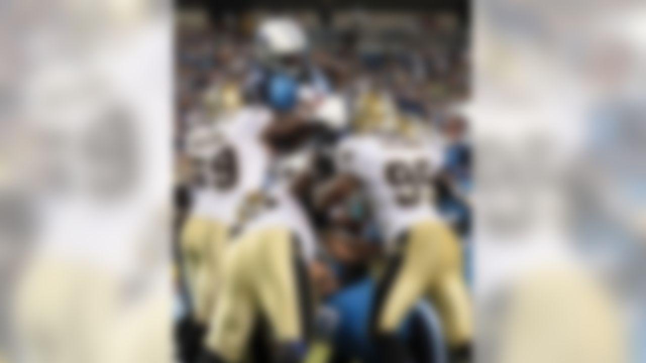 Tennessee Titans running back LeGarrette Blount (42) scores a fourth-quarter touchdown over the New Orleans Saints defense in an NFL preseason football game in Nashville, Tenn., Thursday, Sept. 2, 2010. (AP Photo/Dave Martin)