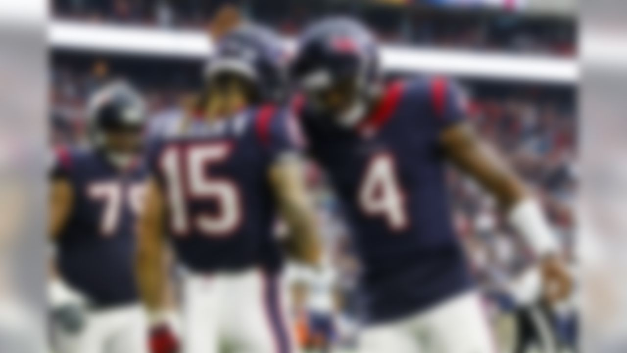 Houston Texans quarterback Deshaun Watson (4) and wide receiver Will Fuller (15) celebrate after a touchdown during an NFL football game against the Tennessee Titans, Sunday, Oct. 1, 2017, in Houston. The Texans defeated the Titans, 57-14. (Ryan Kang/NFL)