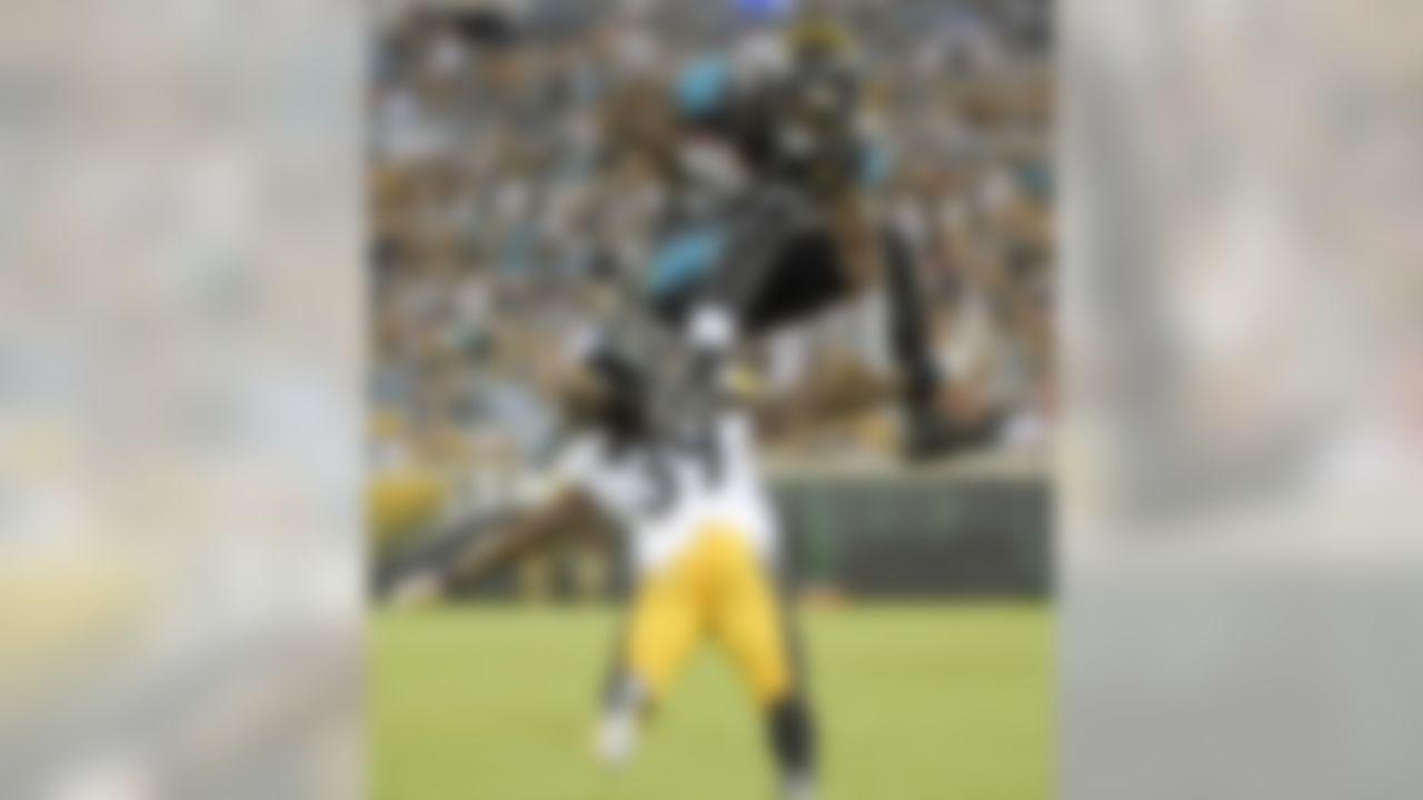 Jacksonville Jaguars running back Bernard Pierce (30) leaps over Pittsburgh Steelers cornerback B.W. Webb (39) during the first half of an NFL preseason football game, Friday, Aug. 14, 2015, in Jacksonville, Fla. (AP Photo/Phelan M. Ebenhack)
