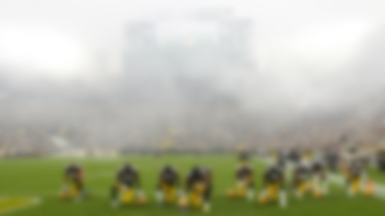 Green Bay Packers players take a knee before a game against the Pittsburgh Steelers at Lambeau Field on October 3, 2021 in Green Bay, Wisconsin.