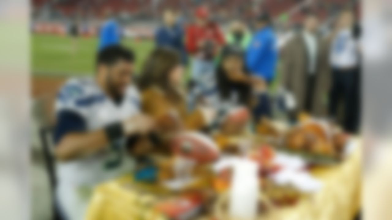 Seattle Seahawks quarterback Russell Wilson (3) and Seattle Seahawks cornerback Richard Sherman (25) with Michele Tafoya during the NFL regular season game against the Seattle Seahawks and the San Francisco 49ers on Thursday, Nov. 27, 2014 at the Levi's Stadium in Santa Clara, Calif. (Ric Tapia/NFL)