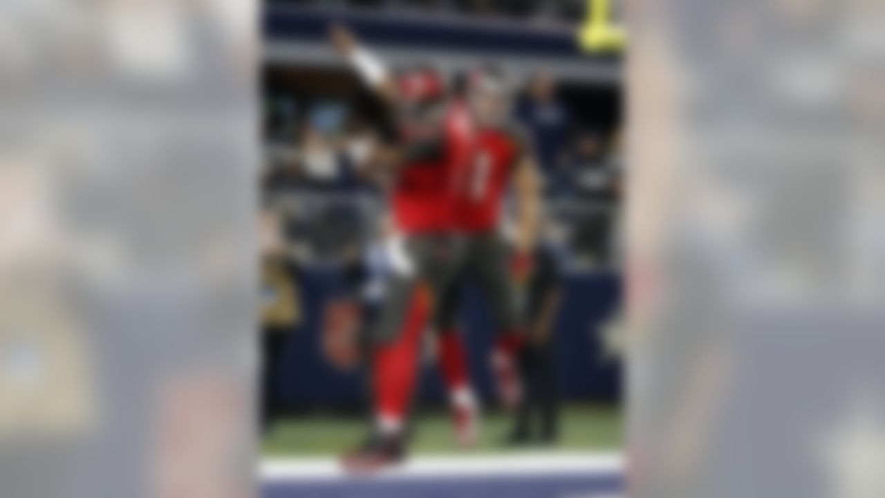 Tampa Bay Buccaneers' Jameis Winston, left, and Adam Humphries, right, celebrate a touchdown catch by Humphries in the second half of an NFL football game against the Dallas Cowboys on Sunday, Dec. 18, 2016, in Arlington, Texas. (AP Photo/Michael Ainsworth)
