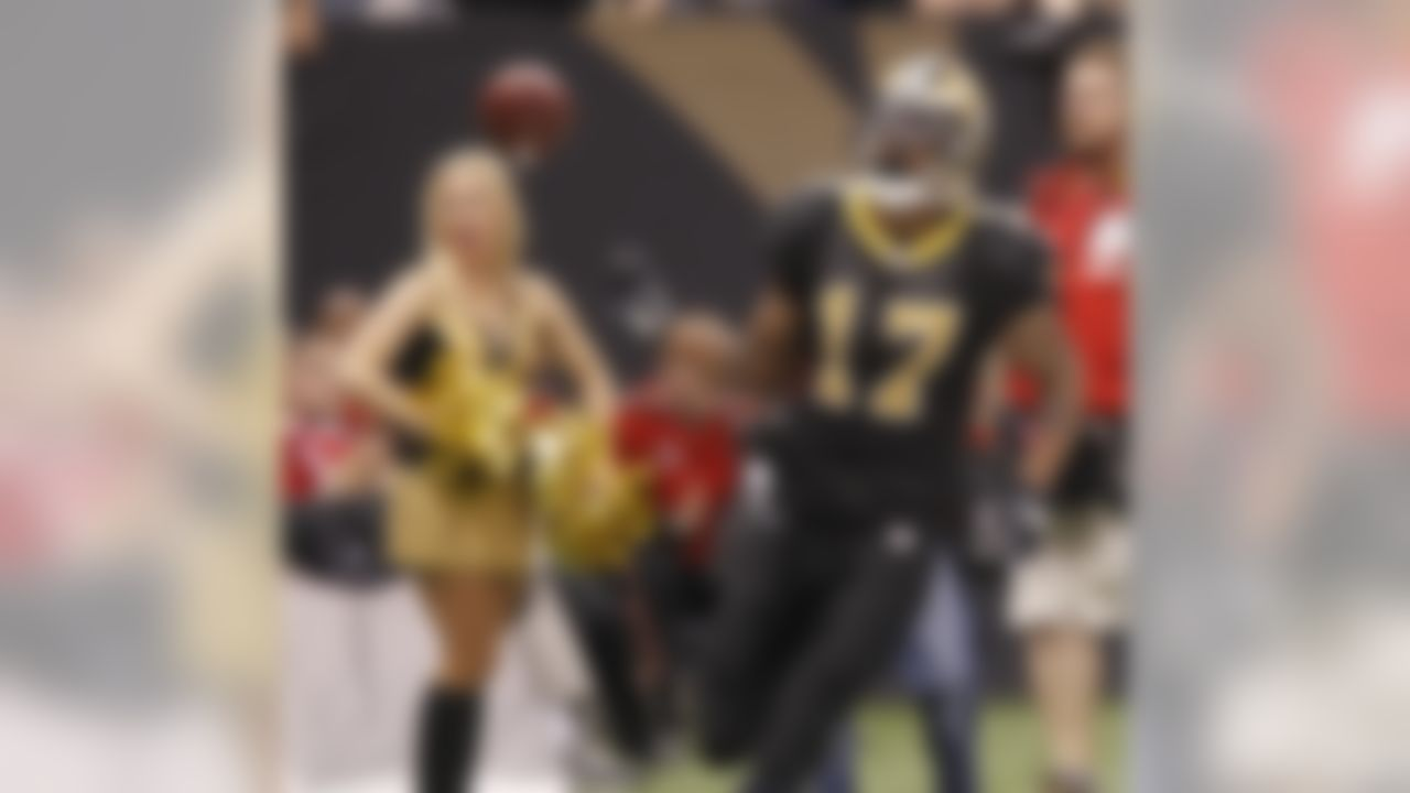 New Orleans Saints wide receiver Robert Meachem (17) throws the ball to an official after a first down catch during an NFL football game at the Louisiana Superdome in New Orleans, Sunday, Nov. 21, 2010. (AP Photo/Bill Haber)