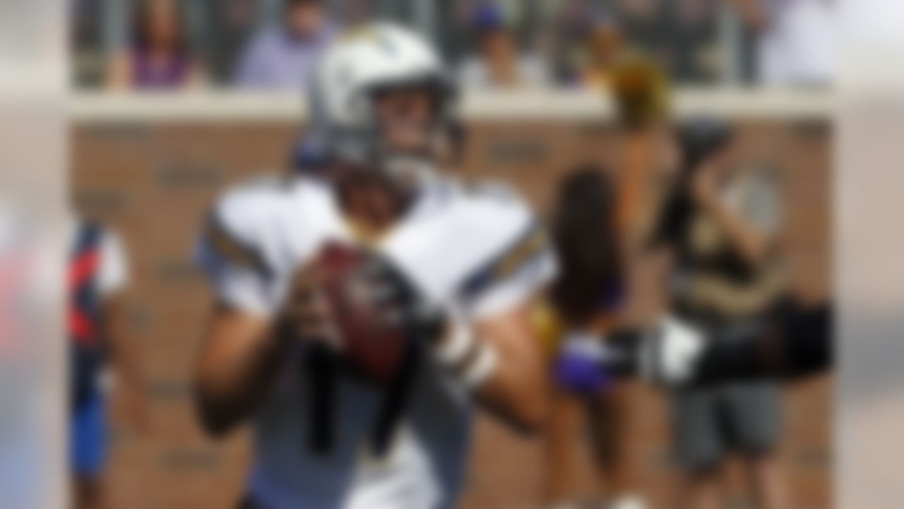 San Diego Chargers quarterback Philip Rivers (17) throws against the Minnesota Vikings in the first half of an NFL football game in Minneapolis, Sunday, Sept. 27, 2015. (AP Photo/Jim Mone)