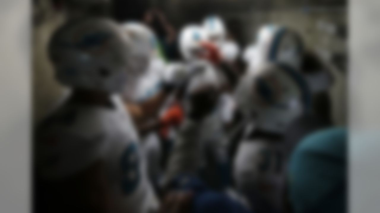 Members of the Miami Dolphins gather in the tunnel before an NFL football game against the San Diego Chargers, Sunday, Dec. 20, 2015, in San Diego. (AP Photo/Gregory Bull)