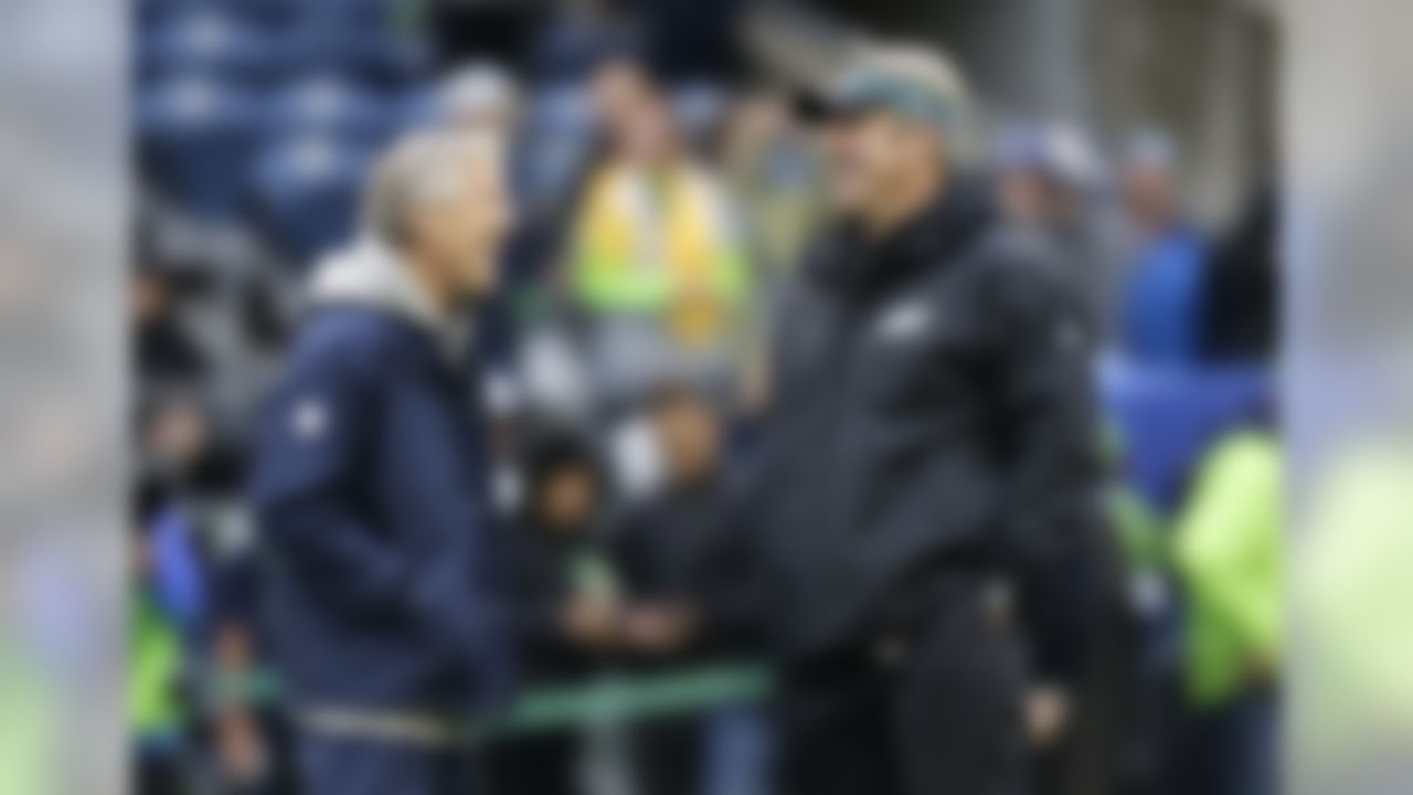 Seattle Seahawks head coach Pete Carroll, left, talks with Philadelphia Eagles head coach Doug Pederson, right, before an NFL football game, Sunday, Nov. 20, 2016, in Seattle. (AP Photo/Stephen Brashear)