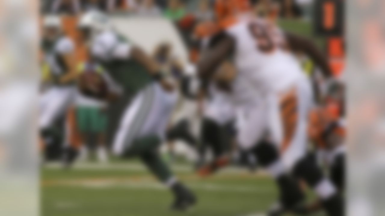 New York Jets quarterback Geno Smith (7) runs against the Cincinnati Bengals in the first half of an NFL preseason football game, Saturday, Aug. 16, 2014, in Cincinnati. (AP Photo/Tony Tribble)