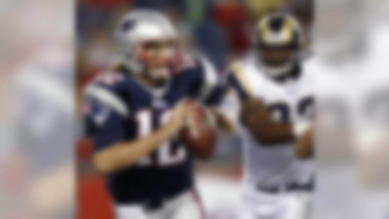 New England Patriots quarterback Tom Brady scrambles away from St. Louis Rams linebacker Bobby Carpenter during the first quarter of an NFL preseason football game in Foxborough, Mass., Thursday, Aug. 26, 2010. (AP Photo/Winslow Townson)