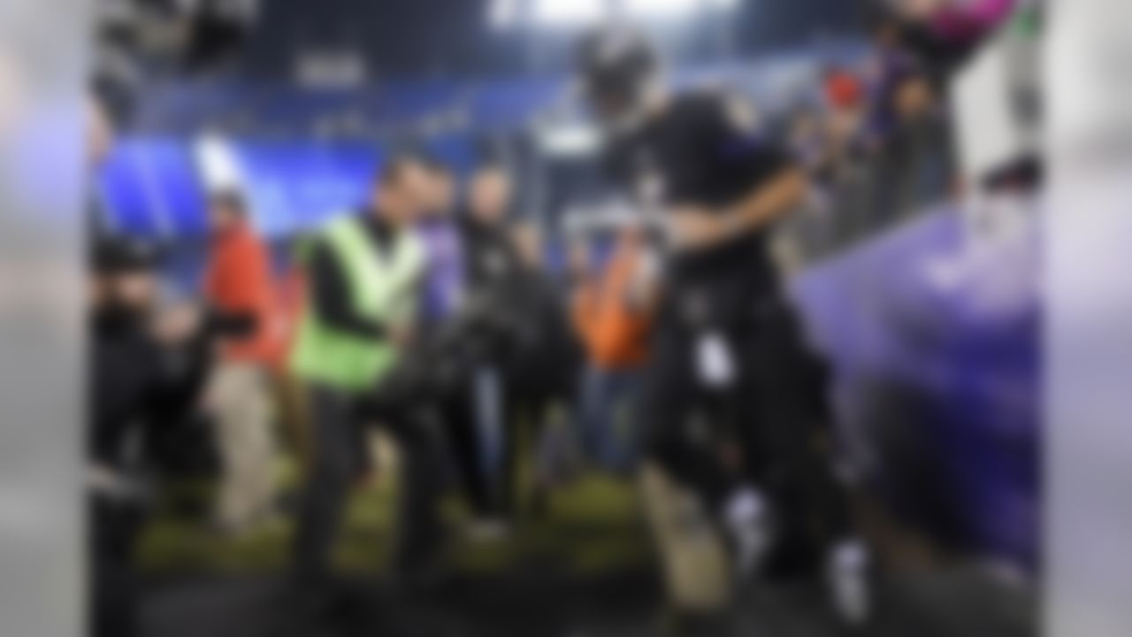 Baltimore Ravens quarterback Joe Flacco (5) runs onto the field to warm up before an NFL football game against the Houston Texans in Baltimore, Monday, Nov. 27, 2017. (AP Photo/Nick Wass)