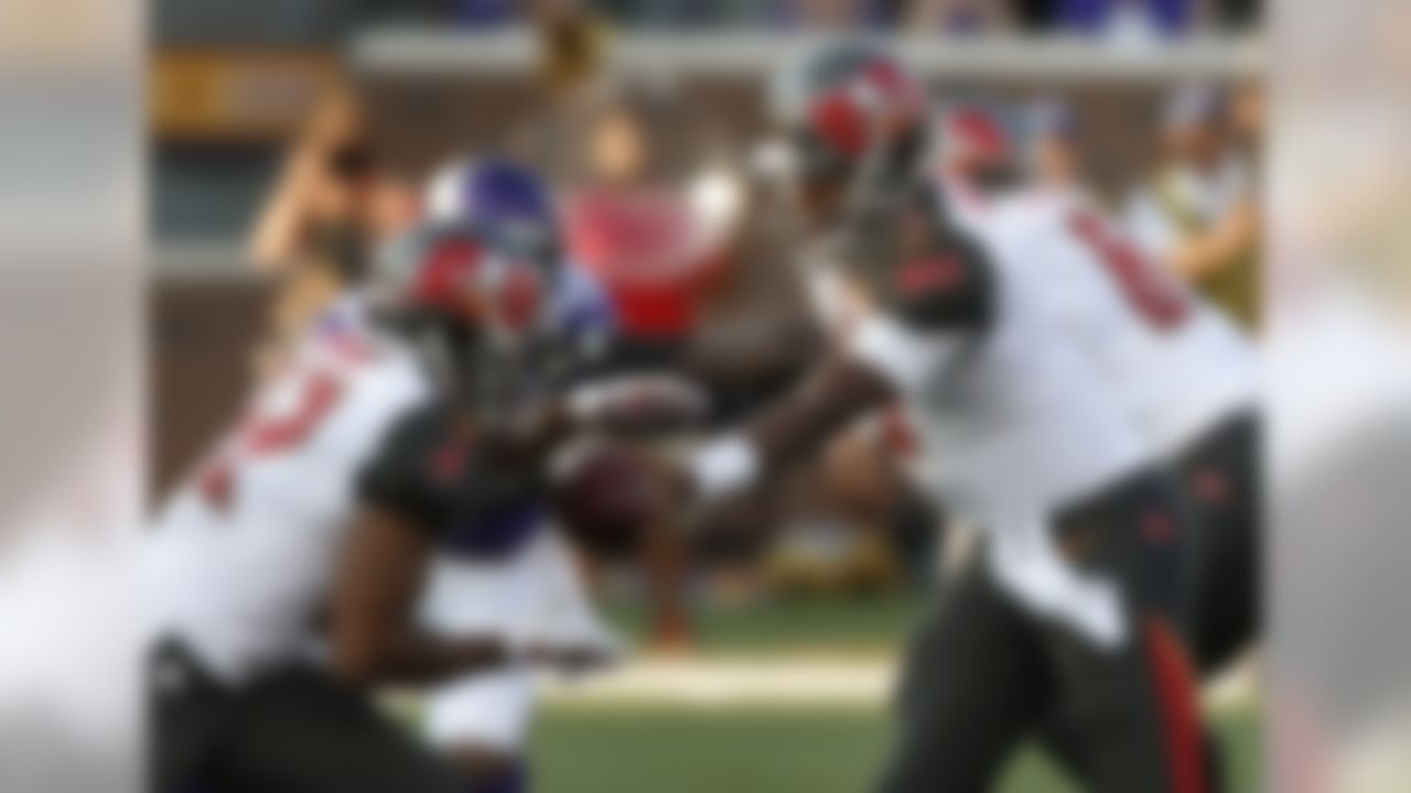 Tampa Bay Buccaneers quarterback Jameis Winston (3) hands off to running back Doug Martin during the first half of a preseason NFL football game against the Minnesota Vikings on Saturday, Aug. 15, 2015,  in Minneapolis. (AP Photo/Jim Mone)