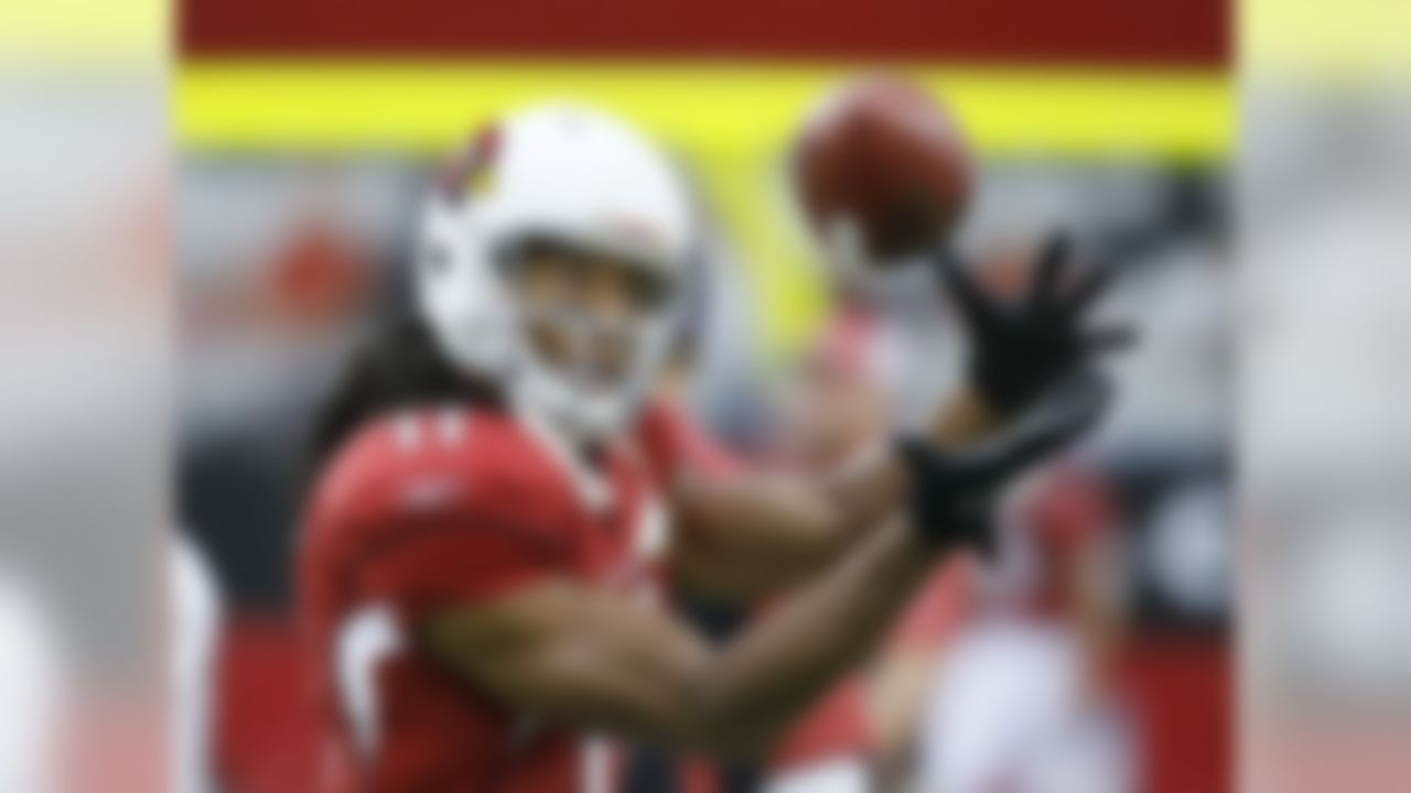 Arizona Cardinals wide receiver Larry Fitzgerald warms up before playing an NFL pre season football game against the Houston Texans on Saturday, Aug. 14, 2010, in Glendale, Ariz. (AP Photo/Rick Scuteri)