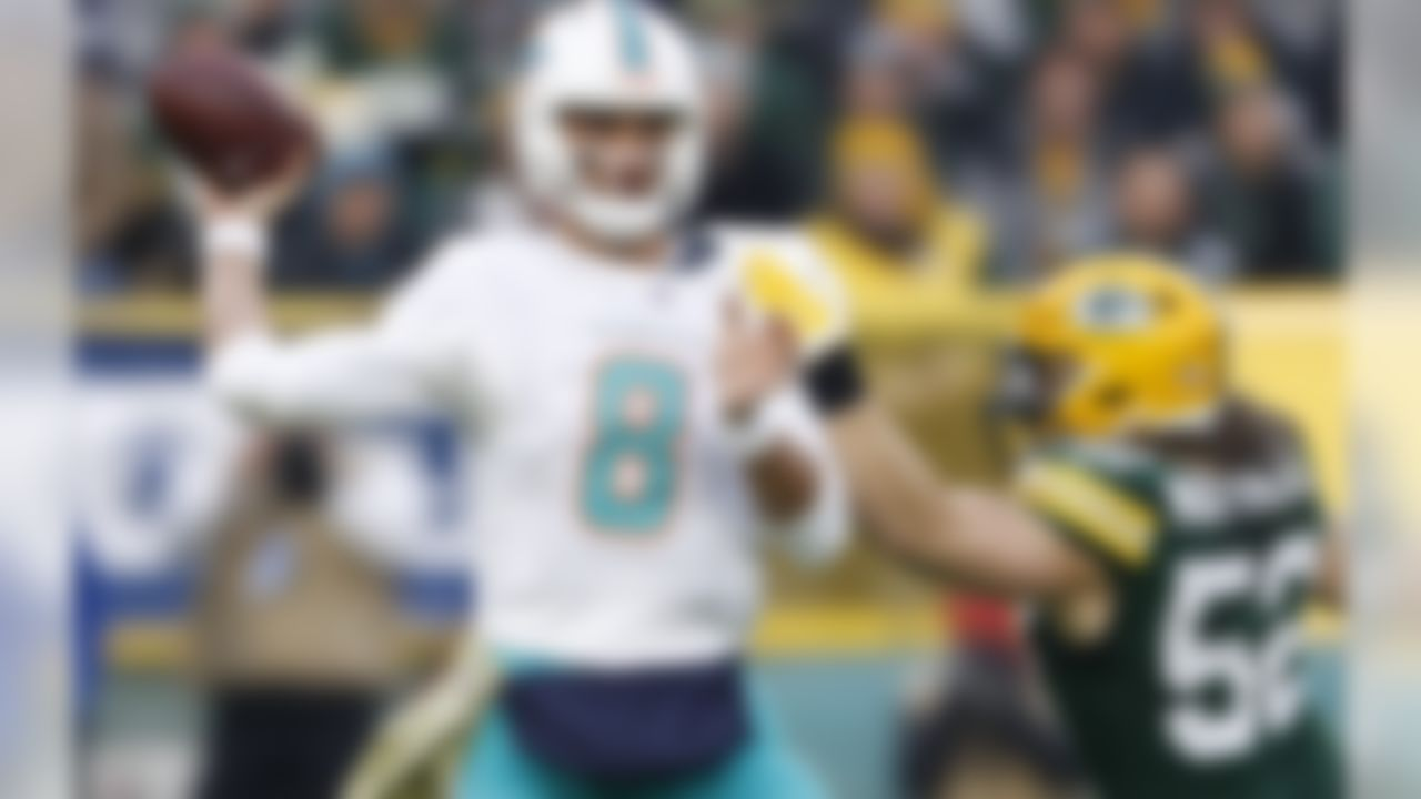 Miami Dolphins' Brock Osweiler tries to avoid Green Bay Packers' Clay Matthews during the first half of an NFL football game Sunday, Nov. 11, 2018, in Green Bay, Wis. (AP Photo/Matt Ludtke)