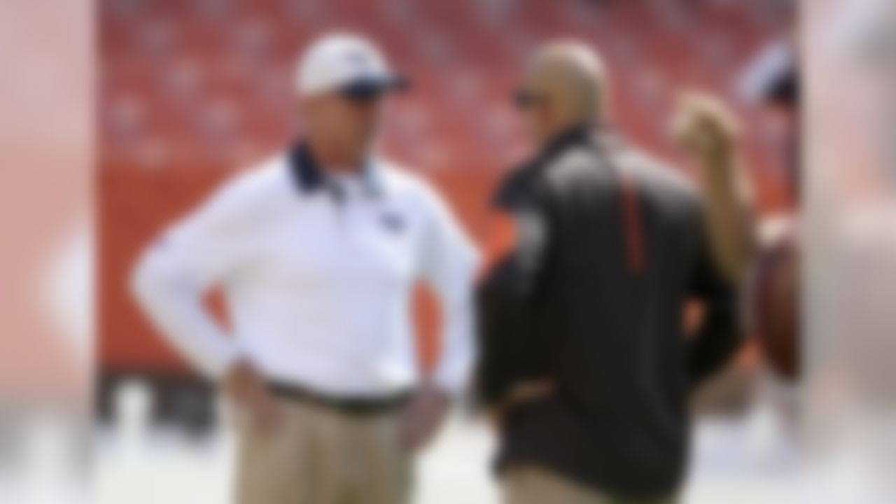 Tennessee Titans head coach Ken Whisenhunt, left, and Cleveland Browns head coach Mike Pettine talk before an NFL football game, Sunday, Sept. 20, 2015, in Cleveland. (AP Photo/Ron Schwane)