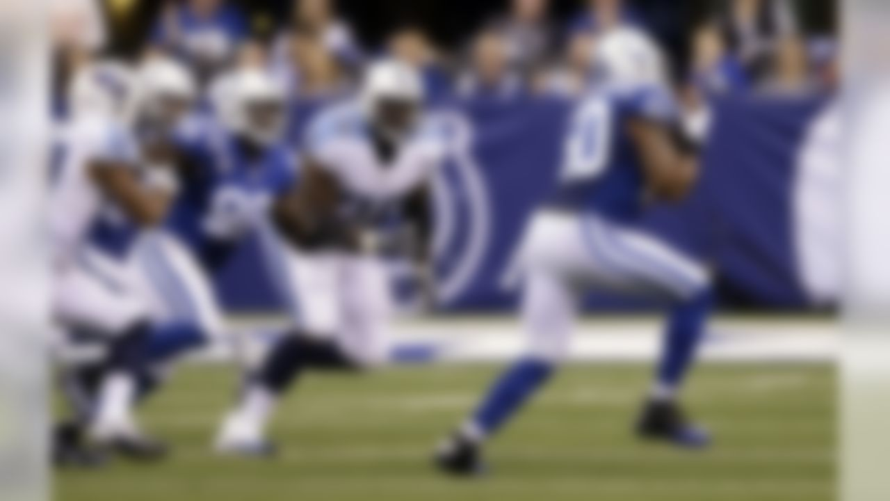 Indianapolis Colts inside linebacker Jerrell Freeman (50) intercepts a pass and returns it for a touchdown against the Tennessee Titans during the second half of an NFL football game in Indianapolis, Sunday, Jan. 3, 2016. (AP Photo/Darron Cummings)