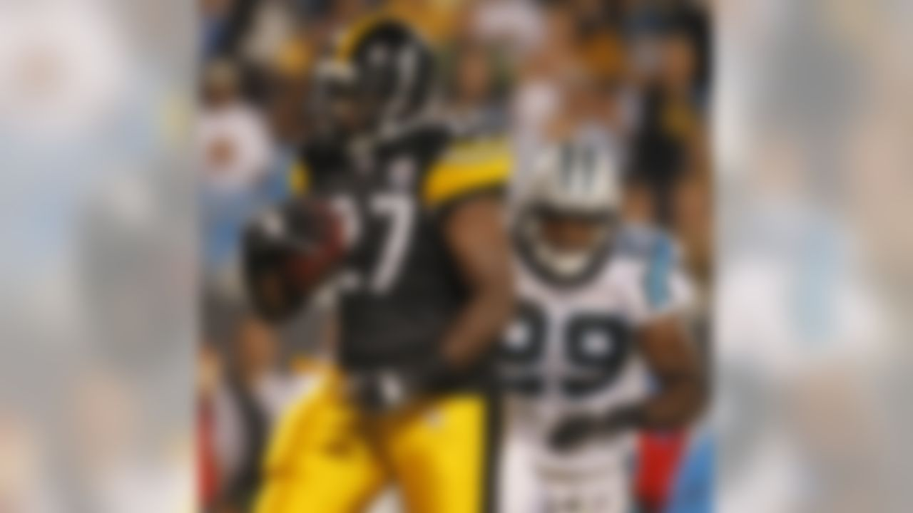 Pittsburgh Steelers' Jonathan Dwyer (27) runs past Carolina Panthers' Jordan Pugh (29) for a touchdown during the second quarter of a preseason NFL football game in Charlotte, N.C., Thursday, Sept. 1, 2011. (AP Photo/Bob Leverone)