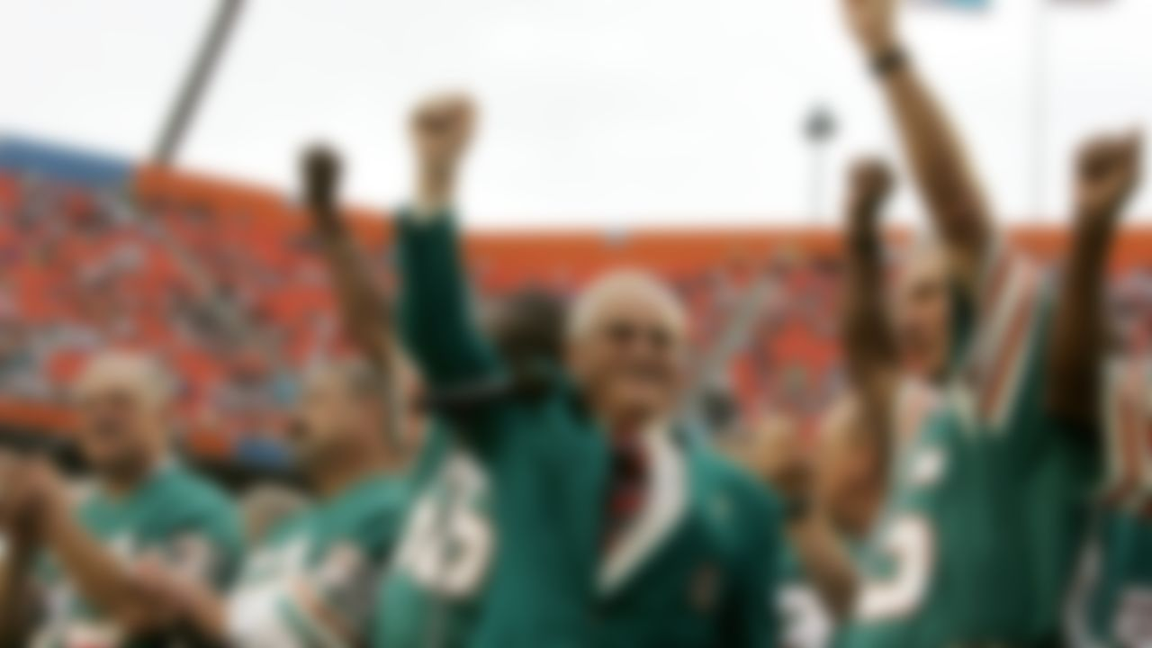 Former Miami Dolphins coach Don Shula, center, waves with former players from the 1972 unbeaten team during a ceremony at an NFL football game at Dolphin Stadium in Miami From left are running back Larry Csonka (39), center Jim Langer (62) and linebacker Nick Buoniconti, right. Pro Football Hall of Fame center Jim Langer, who was literally in the middle of the Miami Dolphins' 1972 perfect season, has died at the age of 71. Langer died Thursday, Aug. 29, 2019, at a Coon Rapids, Minnesota hospital near his home of a sudden heart-related problem, said his wife, Linda.