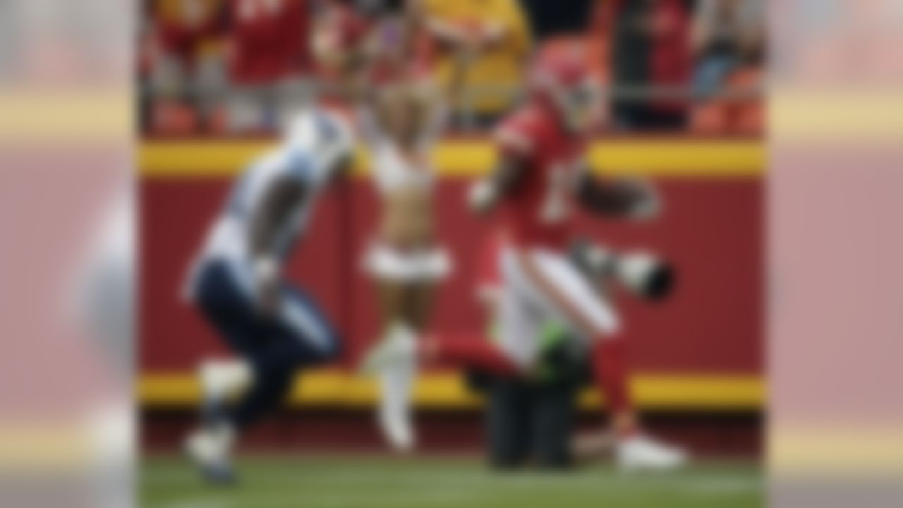 Kansas City Chiefs wide receiver Jeremy Maclin (19) scores a touchdown as he is pursued by Tennessee Titans safety Da'Norris Searcy (21) during the first half of a preseason NFL football game at Arrowhead Stadium in Kansas City, Mo., Friday, Aug. 28, 2015. (AP Photo/Charlie Riedel)