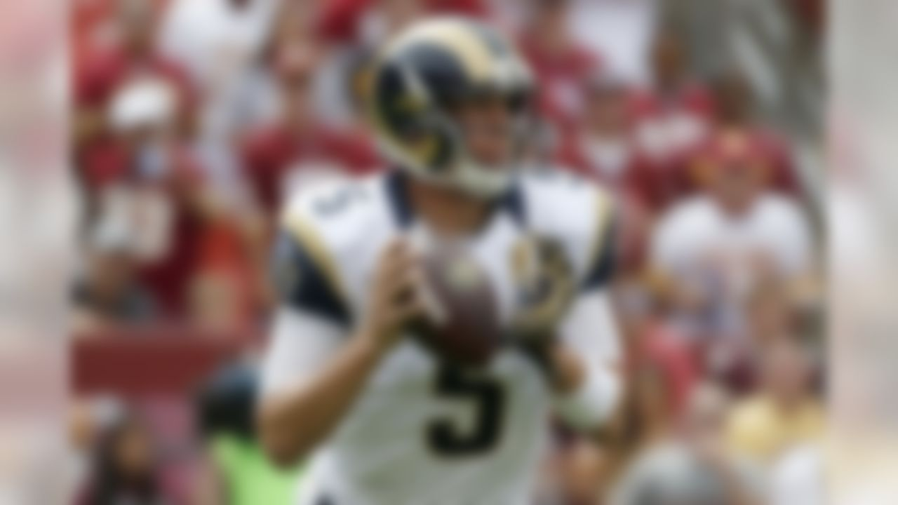 St. Louis Rams quarterback Nick Foles (5) looks for an open man during the first half of an NFL football game against the Washington Redskins in Landover, Md., Sunday, Sept. 20, 2015. (AP Photo/Alex Brandon)
