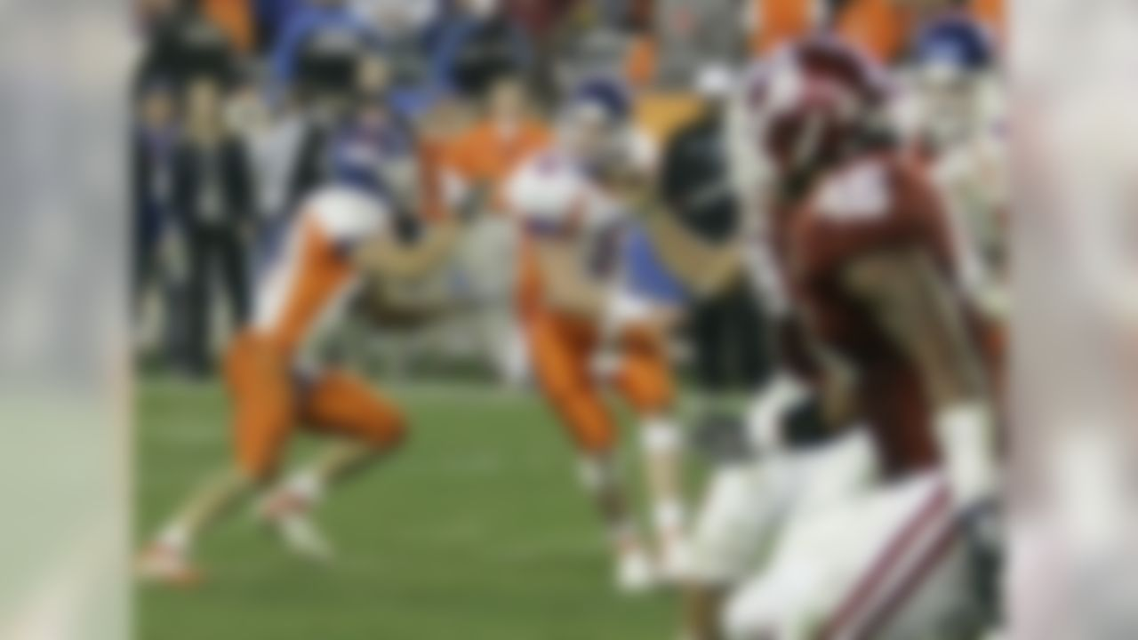 """What makes it so special is that the two teams combined for 22 points in the final 86 seconds of regulation, with Boise State blowing an 18-point lead and twice rallying to tie the game. The Broncos, fighting for BCS respect despite an unblemished season, scored a touchdown on a fourth-and-18, hook-and-ladder play with seven seconds left to send the game into overtime. Adrian Peterson ran for a 25-yard touchdown to open the OT scoring, but Boise State matched it, then went for two on a Statue of Liberty play and got it when RB Ian Johnson took the handoff and went untouched into the end zone. Johnson then scored again -- by proposing to his cheerleader girlfriend on the field. She said """"yes."""""""