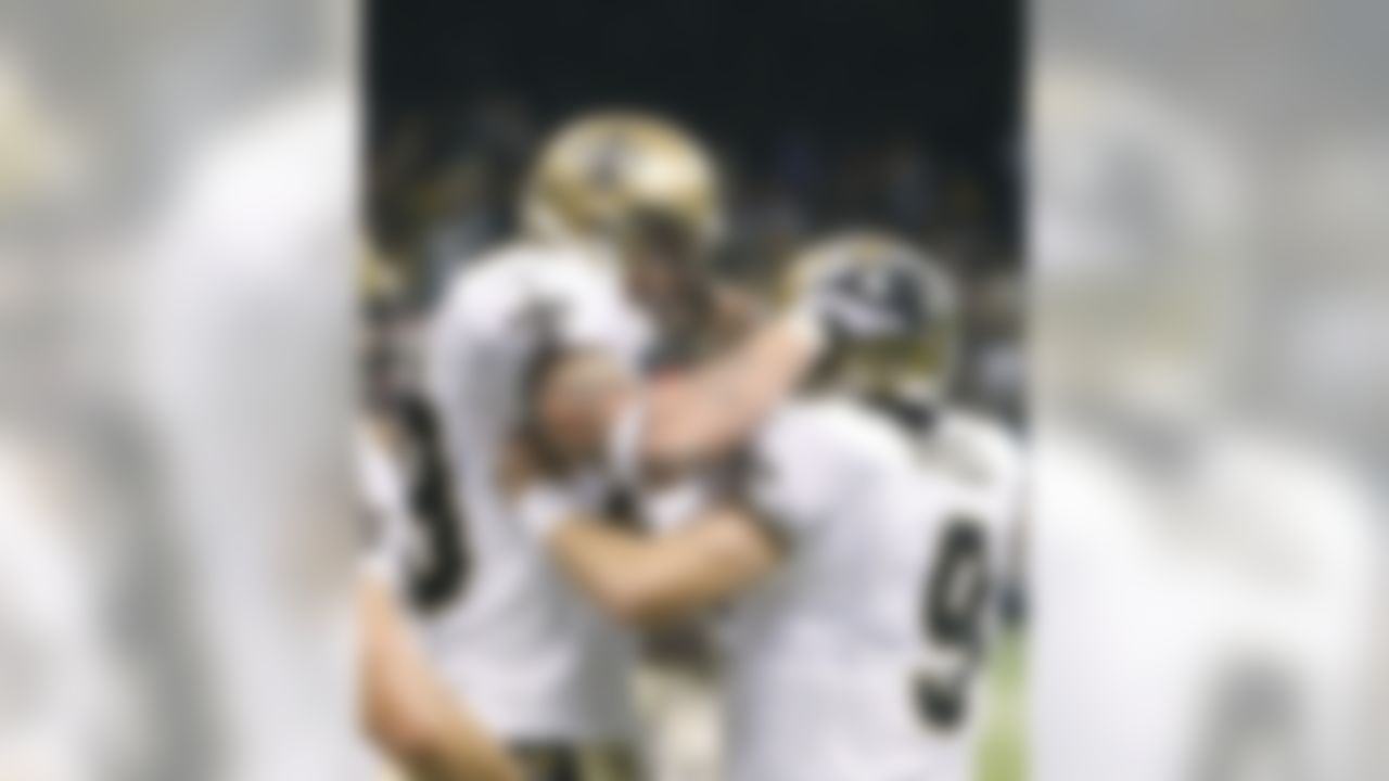 New Orleans Saints quarterback Drew Brees (9) congratulates tight end Jeremy Shockey, left, after Shockey caught a touchdown pass against the New York Giants in the first half of their NFL football game in New Orleans, Sunday, Oct. 18, 2009.  [ (AP Photo/Bill Haber)