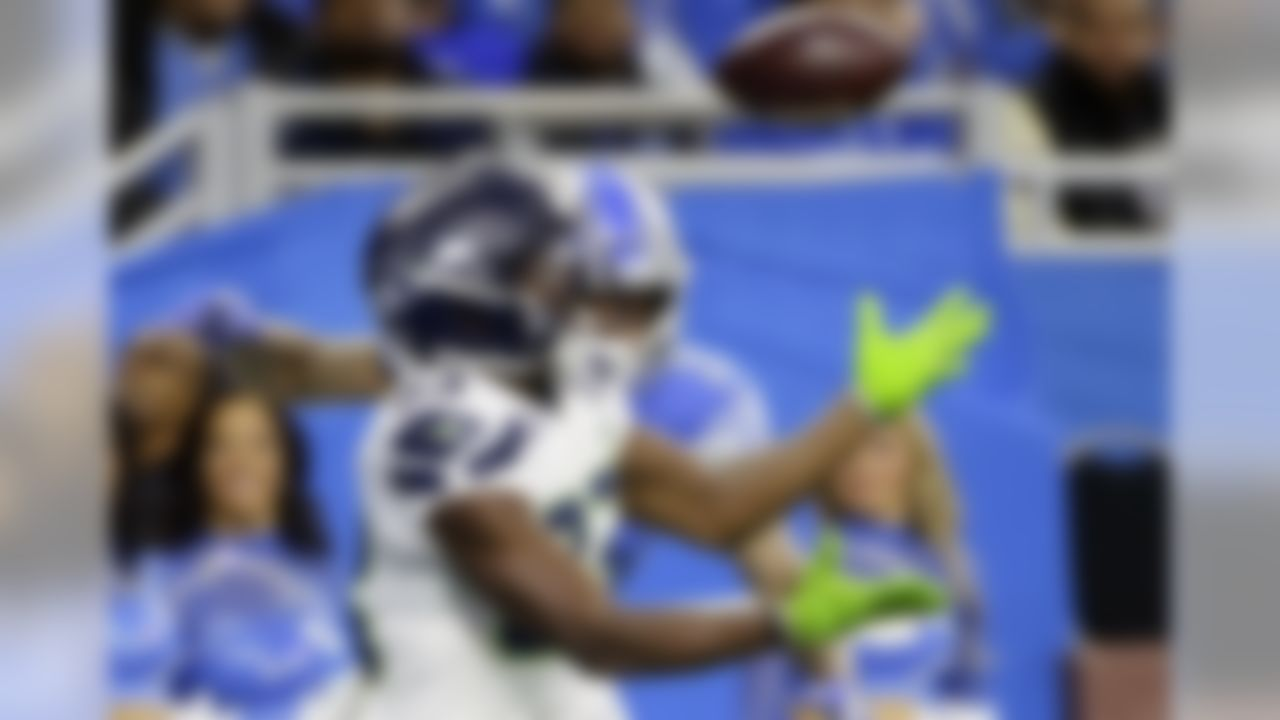 Seattle Seahawks wide receiver David Moore (83) catches a 15-yard pass for a touchdown as Detroit Lions cornerback Teez Tabor (31) defends during the first half of an NFL football game, Sunday, Oct. 28, 2018, in Detroit. (AP Photo/Duane Burleson)