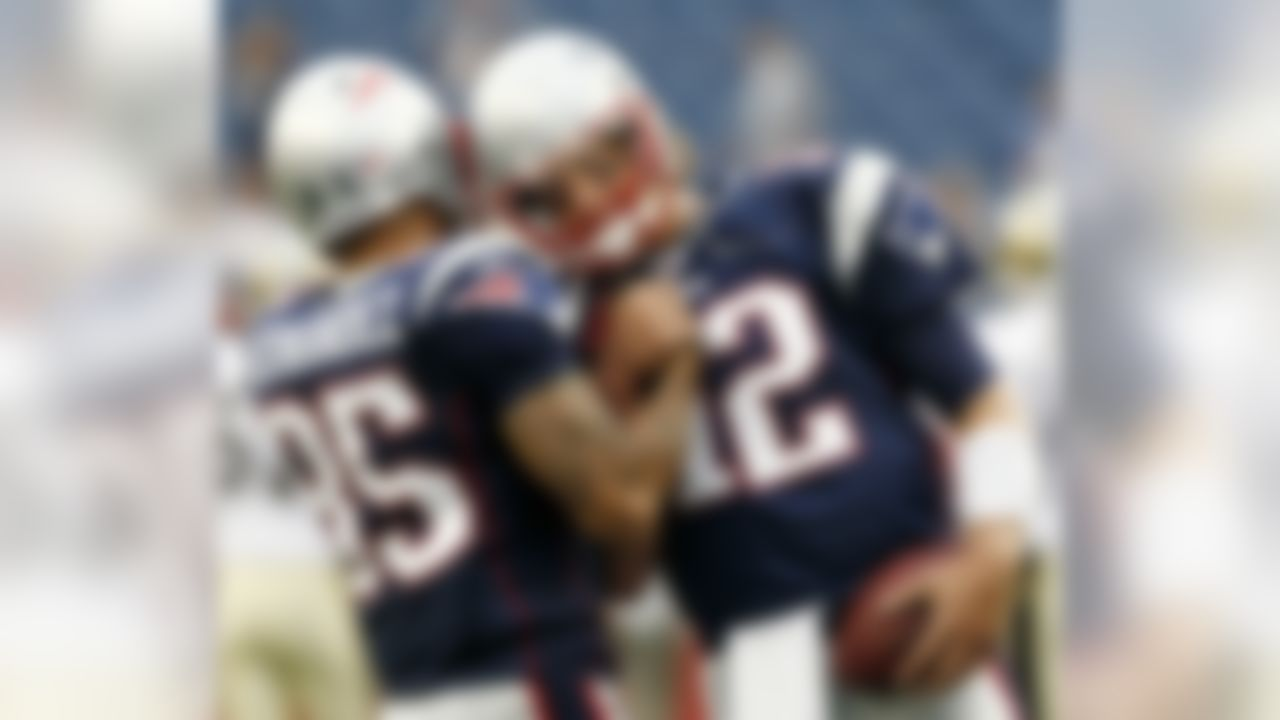 New England Patriots'  Tom Brady (12) bumps helmets with rookie Aaron Hernandez before an NFL preseason football game against the New Orleans Saints in Foxborough, Mass., Thursday, Aug. 12, 2010. (AP Photo/Winslow Townson)