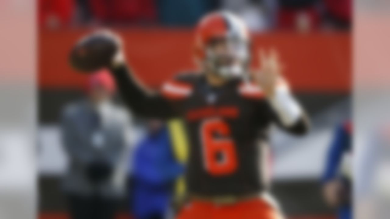 Cleveland Browns quarterback Baker Mayfield prepares to throw in the first half of an NFL football game against the Atlanta Falcons, Sunday, Nov. 11, 2018, in Cleveland. (AP Photo/Ron Schwane)