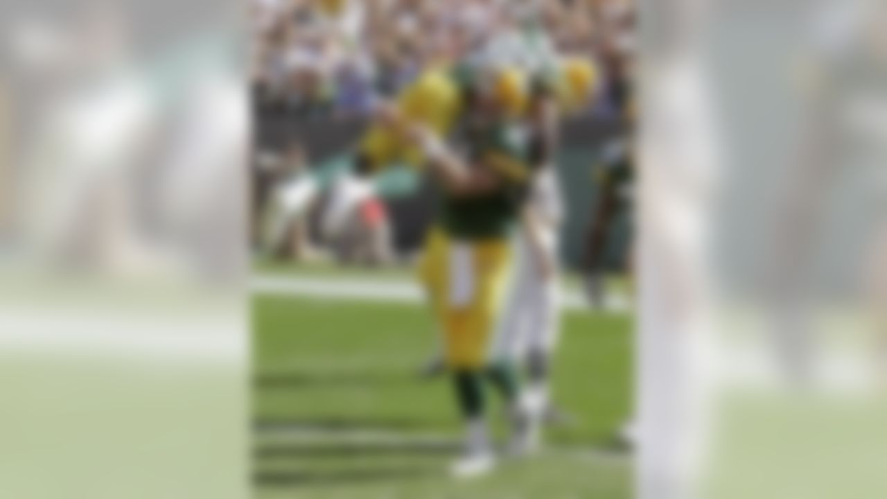 Green Bay Packers quarterback Brett Favre lifts Donald Driver after throwing a touchdown pass to Greg Jennings during the second half of an NFL football game against the San Diego Chargers Sunday, Sept. 23, 2007, in Green Bay, Wis. The touchdown pass tied Dan Marino's all-time NFL record for career TD passes at 420 and rallied the Packers past the San Diego Chargers on their way to a 31-24 victory. Photo by Morry Gash/AP.