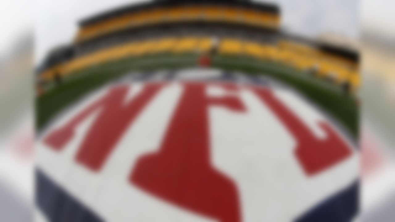 In this image made with a fisheye lens, the NFL logo is displayed on the sideline of Heinz Field as the Tennessee Titans warm up before an NFL football game against the Pittsburgh Steelers, Sunday, Sept. 8, 2013 in Pittsburgh. (AP Photo/Keith Srakocic)