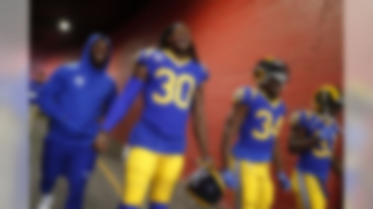 Los Angeles Rams running back Todd Gurley (30), running back Malcolm Brown (34), and running back Justin Davis (33) walk onto the field prior to an NFL football game against the Minnesota Vikings, Thursday, Sept. 27, 2018 in Los Angeles. (Ryan Kang/NFL)