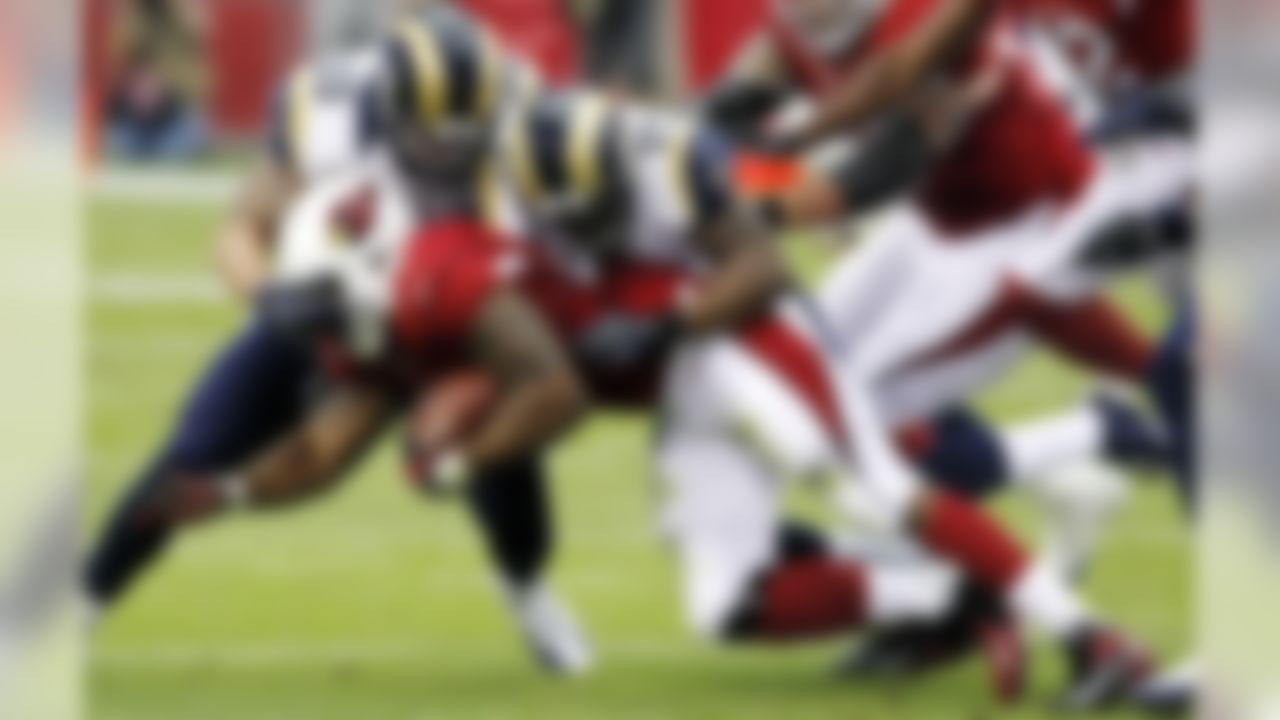Arizona Cardinals running back Beanie Wells is tackled by St. Louis Rams middle linebacker James Laurinaitis (55) and defensive back Quintin Mikell (27) during the first half of an NFL football game, Sunday, Nov. 25, 2012, in Glendale, Ariz. (AP Photo/Ross D. Franklin)