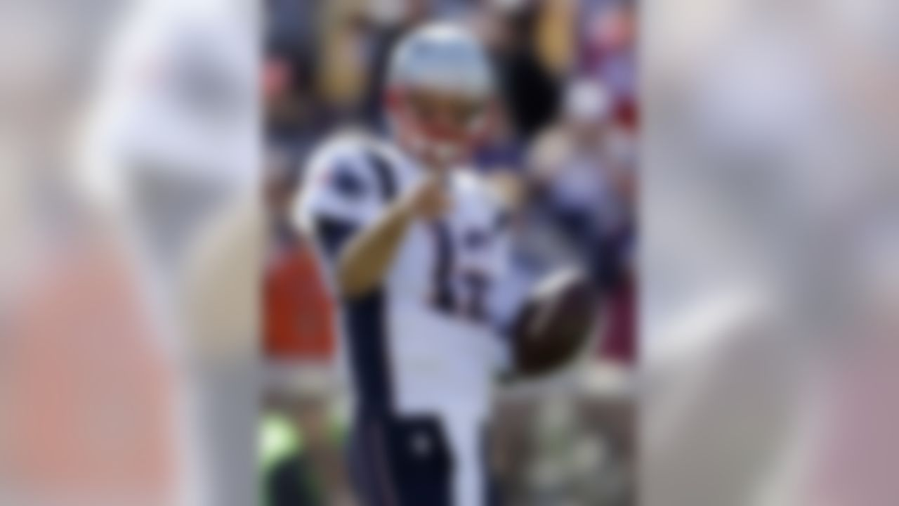 New England Patriots quarterback Tom Brady warms up before the start of an NFL football game against the Minnesota Vikings, Sunday, Sept. 14, 2014, in Minneapolis. (AP Photo/Jeff Roberson)