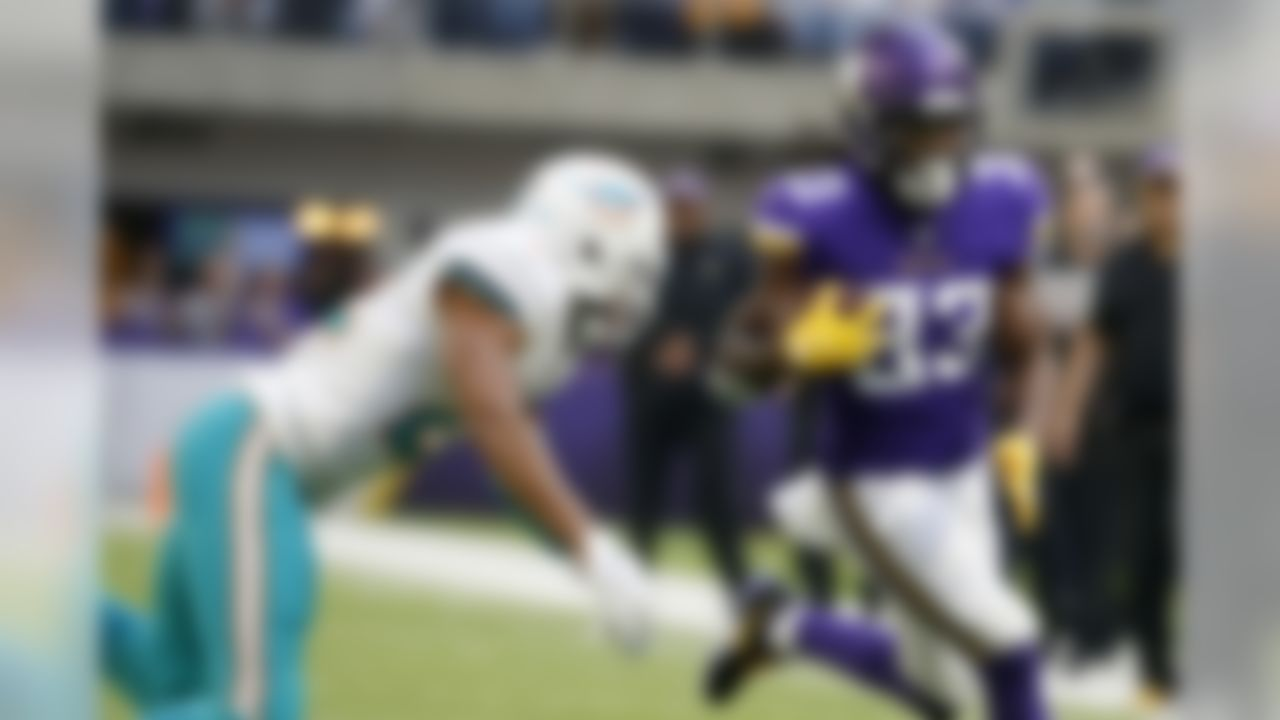 Minnesota Vikings running back Dalvin Cook, right, runs from Miami Dolphins strong safety T.J. McDonald, left, during the first half of an NFL football game, Sunday, Dec. 16, 2018, in Minneapolis. (AP Photo/Bruce Kluckhohn)