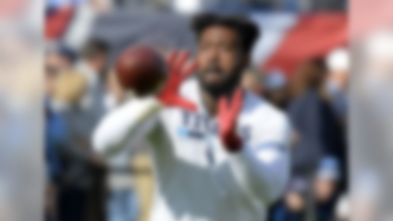 Tennessee Titans tight end Delanie Walker warms up before an NFL football game against the Houston Texans Sunday, Dec. 3, 2017, in Nashville, Tenn. (AP Photo/Mark Zaleski)