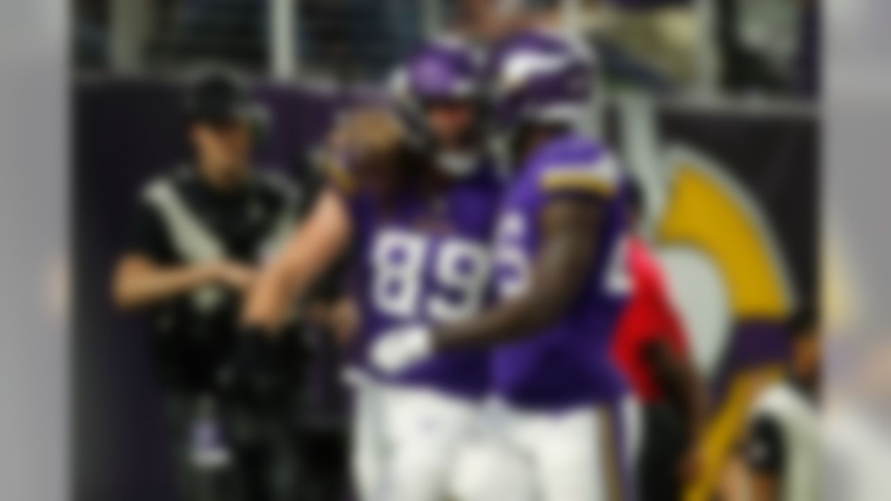 Minnesota Vikings tight end David Morgan (89) celebrates with Minnesota Vikings running back Latavius Murray (25) during an NFL preseason football game against the Seattle Seahawks on Aug. 24, 2018 in Minneapolis.