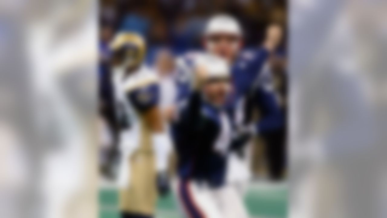 New England Patriots' kicker Adam Vinatieri (4) celebrates with teammate Ken Walter, back, after kicking a game-winning 48-yard field goal to beat the St. Louis Rams 20-17 in Super Bowl XXXVI at the Louisiana Superdome in New Orleans. (AP Photo/Doug Mills)