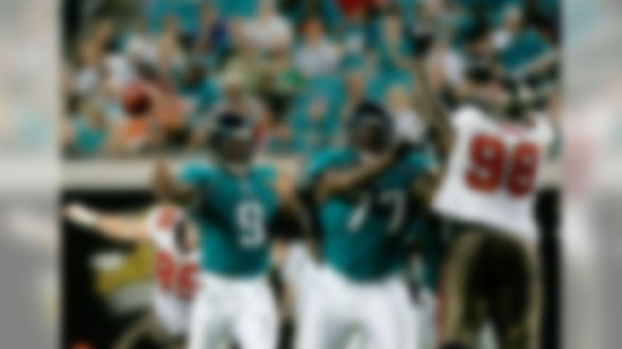 Jacksonville Jaguars quarterback David Garrard, (9),  throws a first quarter pass as teammate Uche Nwaneri, center, blocks Tampa Bay Buccaneers defensive tackle Ryan Sims, right, during an NFL preseason football game, Saturday, Aug. 22, 2009, in Jacksonville, Fla.  Tampa Bay Buccaneers defensive tackle Chris Hovan, left, attempts to sack Garrard. (AP Photo/Phil Coale)