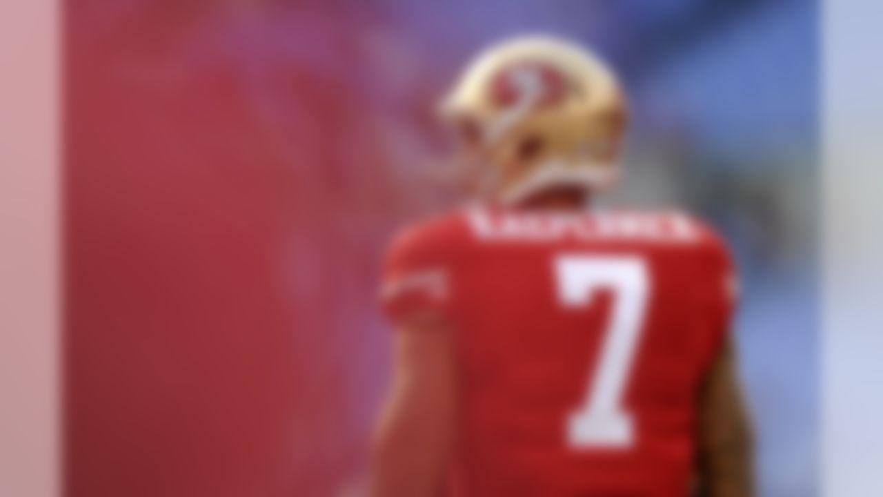 San Francisco 49ers quarterback Colin Kaepernick walks on the field before an NFL preseason football game against the Baltimore Ravens, Thursday, Aug. 7, 2014, in Baltimore. (AP Photo/Gail Burton)