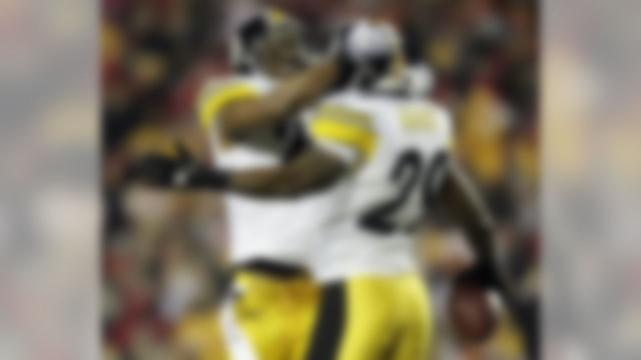 Pittsburgh Steelers defensive back Ryan Mundy (29) celebrates an interception with teammate Ryan Clark (25) during the first half of an NFL football game against the Kansas City Chiefs in Kansas City, Mo., Sunday, Nov. 27, 2011. (AP Photo/Charlie Riedel)