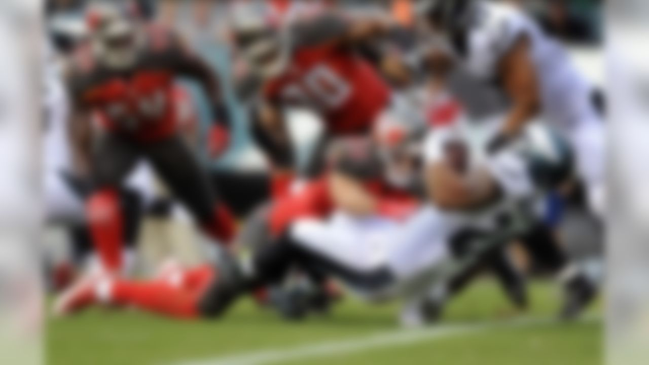 Philadelphia Eagles running back Ryan Mathews (24) spins for a touchdown as Tampa Bay Buccaneers strong safety Chris Conte (23) can't make the tackle during the first half of a preseason NFL football game Thursday, Aug. 11, 2016, in Philadelphia. (AP Photo/Michael Perez)