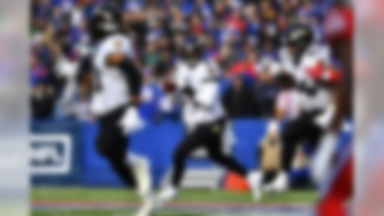 Baltimore Ravens quarterback Lamar Jackson looks to pass during the first half of an NFL football game against the Buffalo Bills in Orchard Park, N.Y., Sunday, Dec. 8, 2019. (AP Photo/Adrian Kraus)