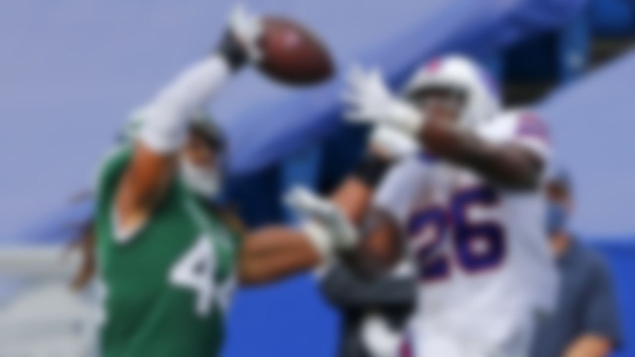 New York Jets linebacker Harvey Langi (44) breaks up a pass intended for Buffalo Bills running back Devin Singletary (26) during the second half of an NFL football game in Orchard Park, N.Y., Sunday, Sept. 13, 2020.